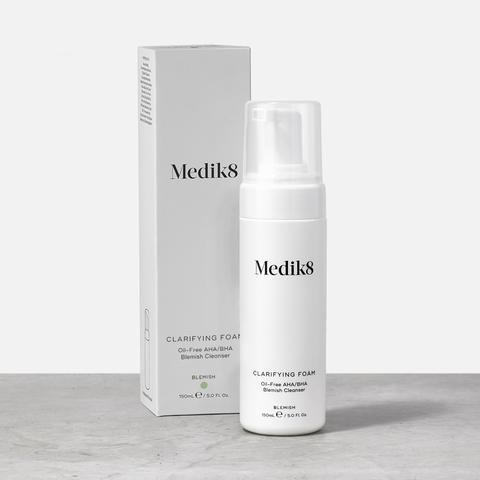 Medik8 Clarifying Foam bottle next to its white packaging